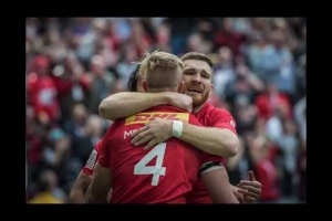 Teammates congratulate John Moonlight on his Rugby Canada career